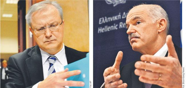 Komisarz ds. finansowych UE Olli Rehn (po lewej) leci w poniedziałek do Aten, aby domagać się od premiera Grecji Jeorjosa Papandreu dodatkowego podwyższenia podatków i ograniczenia kolejnych programów socjalnych