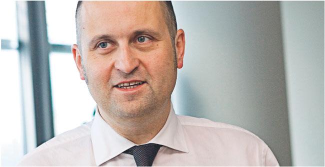 Rafał Stankiewicz, członek zarządu PZU, odpowiada m.in. za projekt nowej organizacji likwidacji szkód Fot. Wojciech Górski