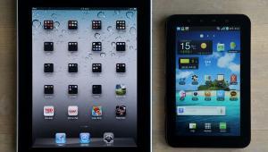Porównanie iPada firmy Apple (po lewej) z tabletem Galaxy firmy Samsung (po prawej). Apple oskarżył Samsunga o kradzież własności intelektualnej. fot. SeongJoon Cho/Bloomberg