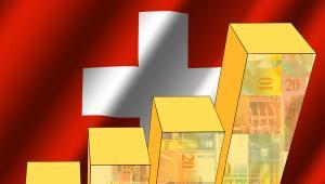 Rosnący kurs franka i flaga Szwajcarii, fot. Stephen Finn