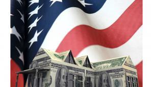 Dom z banknotów na tle amerykańskiej flagi andrea crisante