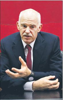 Prasa twierdzi, że w przypadku porażki referendum premier Papandreu miałby rozpisać nowe wybory Fot. Bloomberg